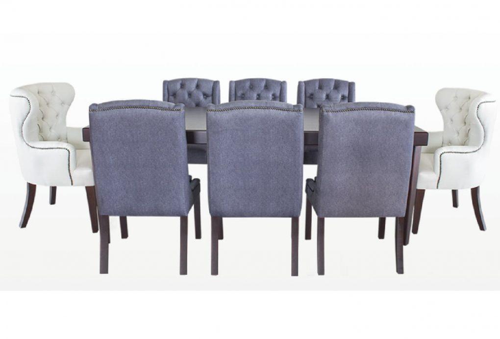 Comedor exclusivo de madera sólida con tronos color blancos, sillas grises, mesas elegantes, modernas, lineales